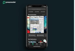 A smartphone showing the Los Angeles Times with PressReader
