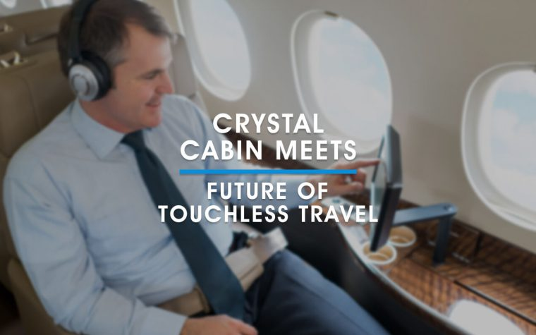 A man sitting on a private jet touches a touchscreen