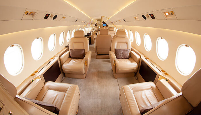 The inside of a Business Jet with six seats visible in cream colour
