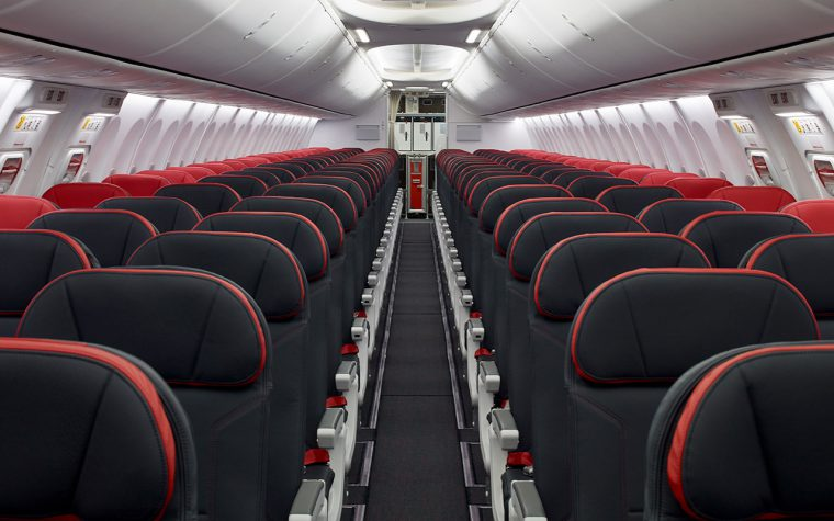 Interior of narrow body aircraft with black seats